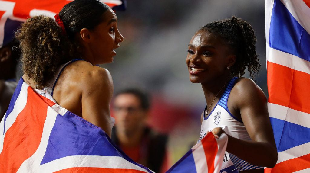 Dina Asher-Smith celebrating with a teammate at Doha 2019