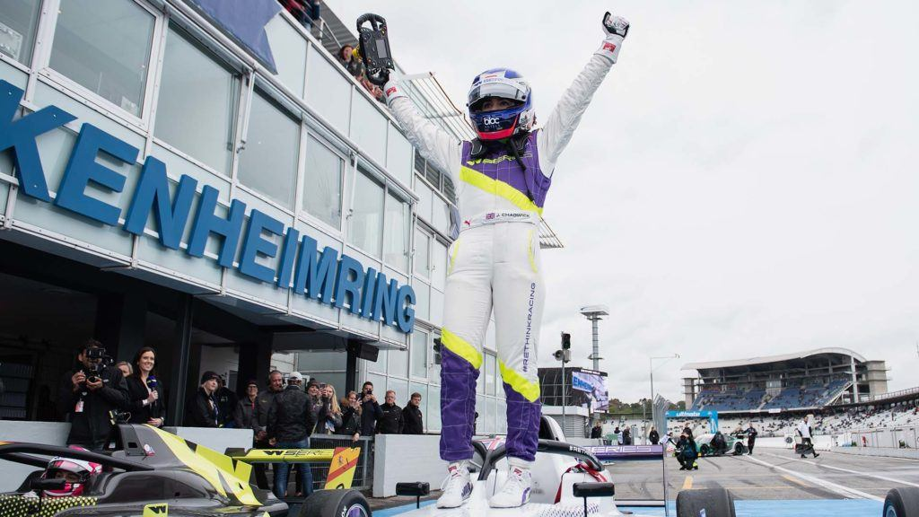 Jamie Chadwick celebrating a race win standing on her car