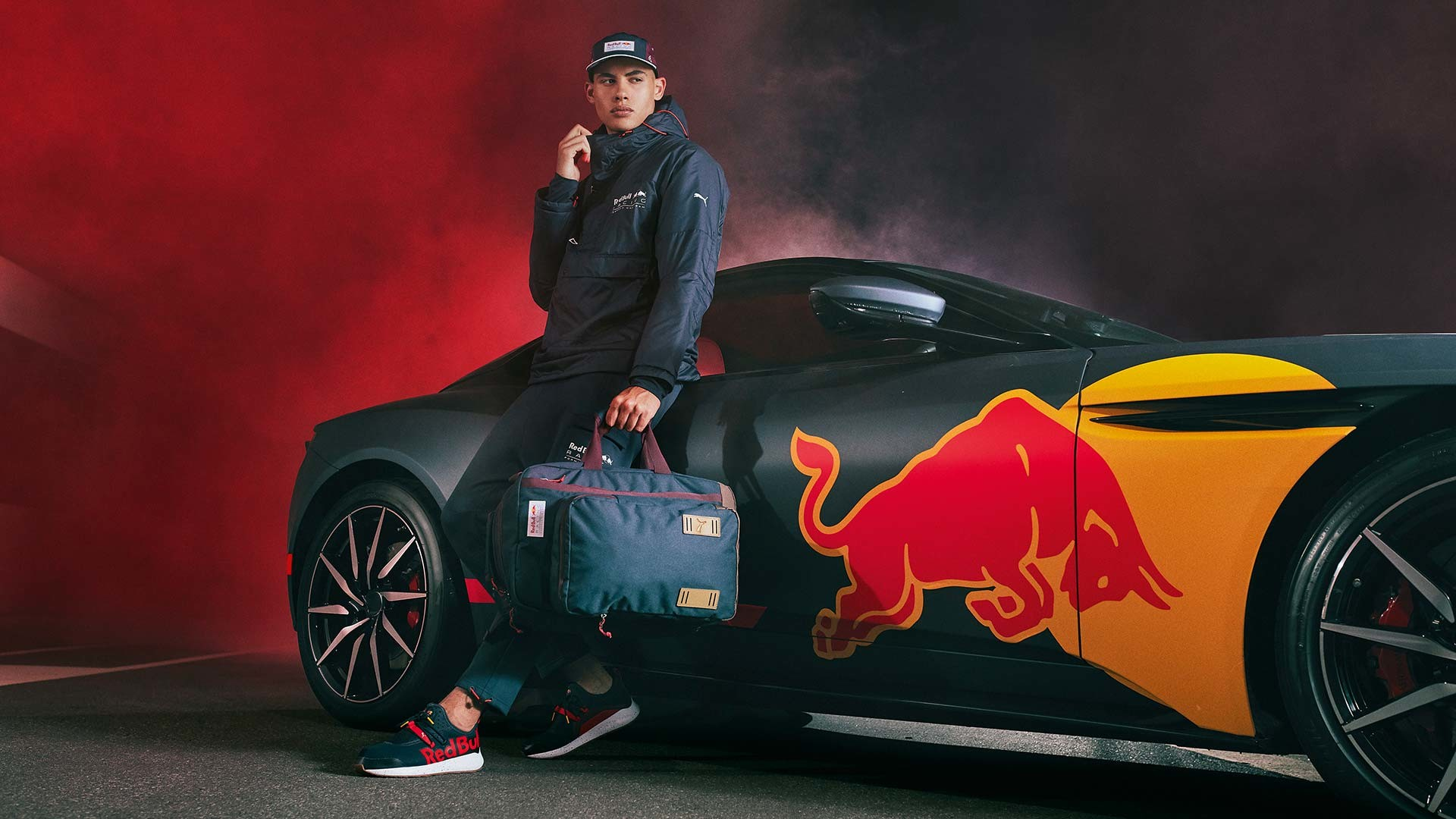 PUMA model in front of Red Bull Racing branded car