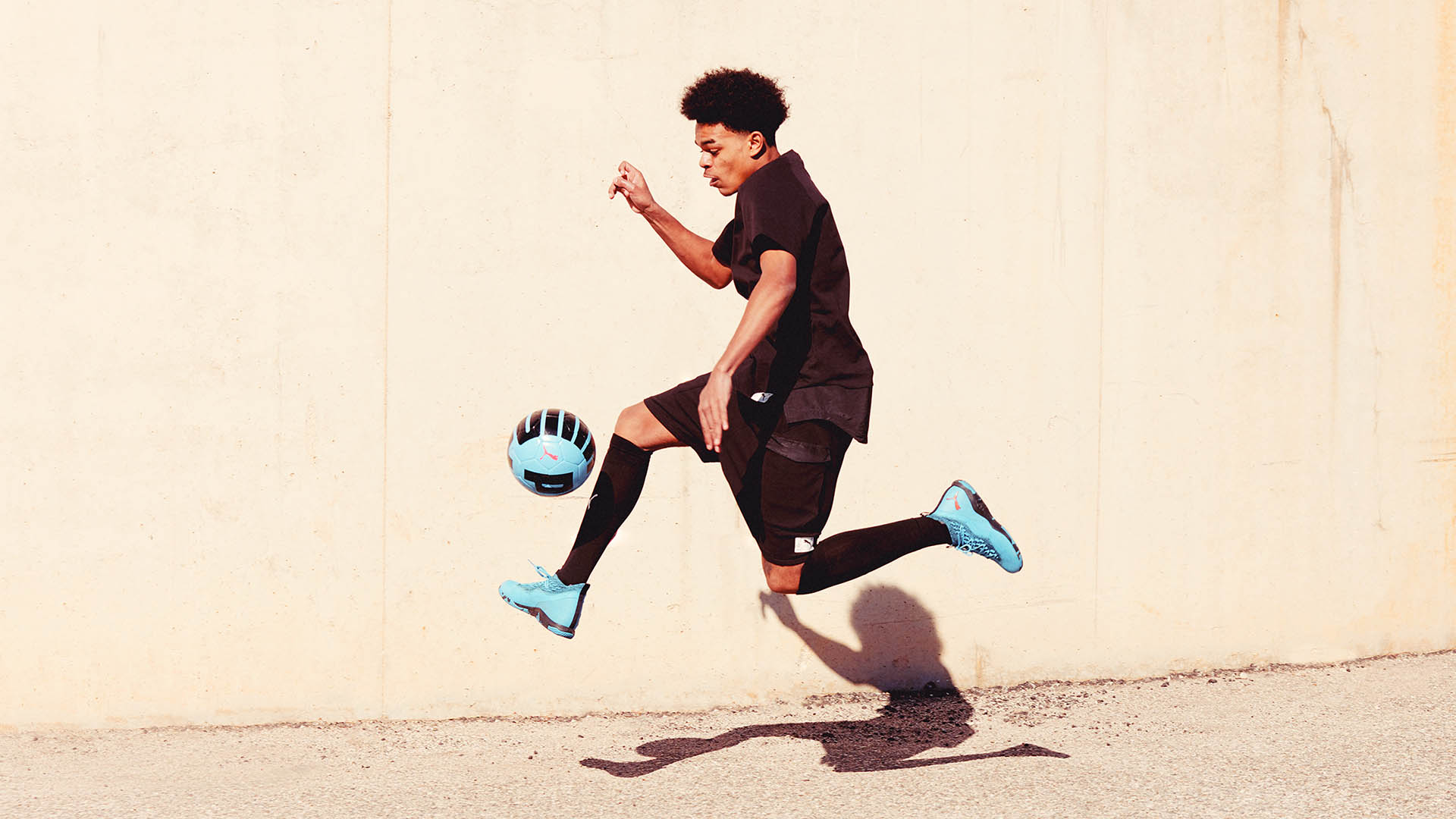 Puma Athlete kicking a football