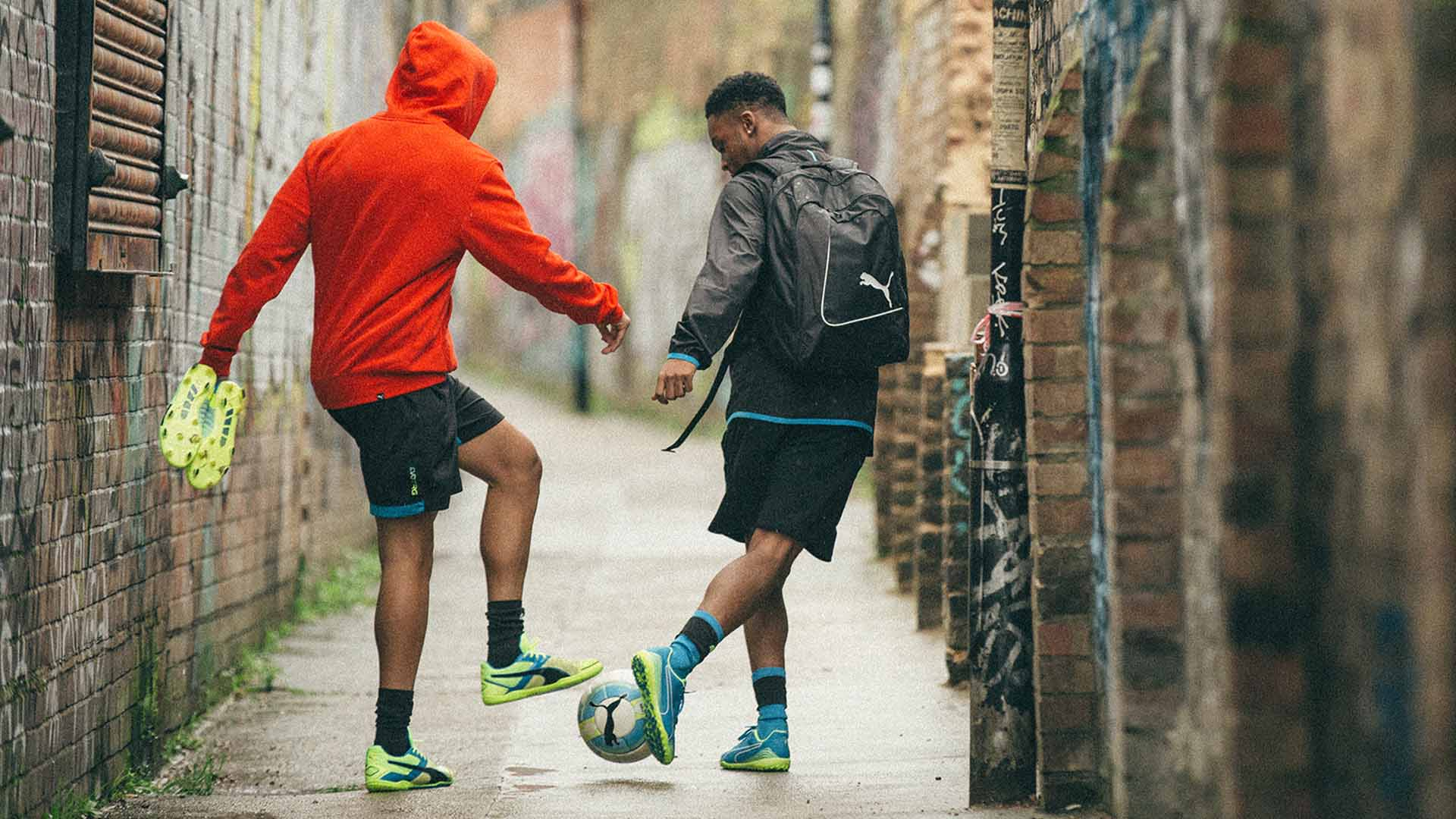 Two Puma athletes playing football