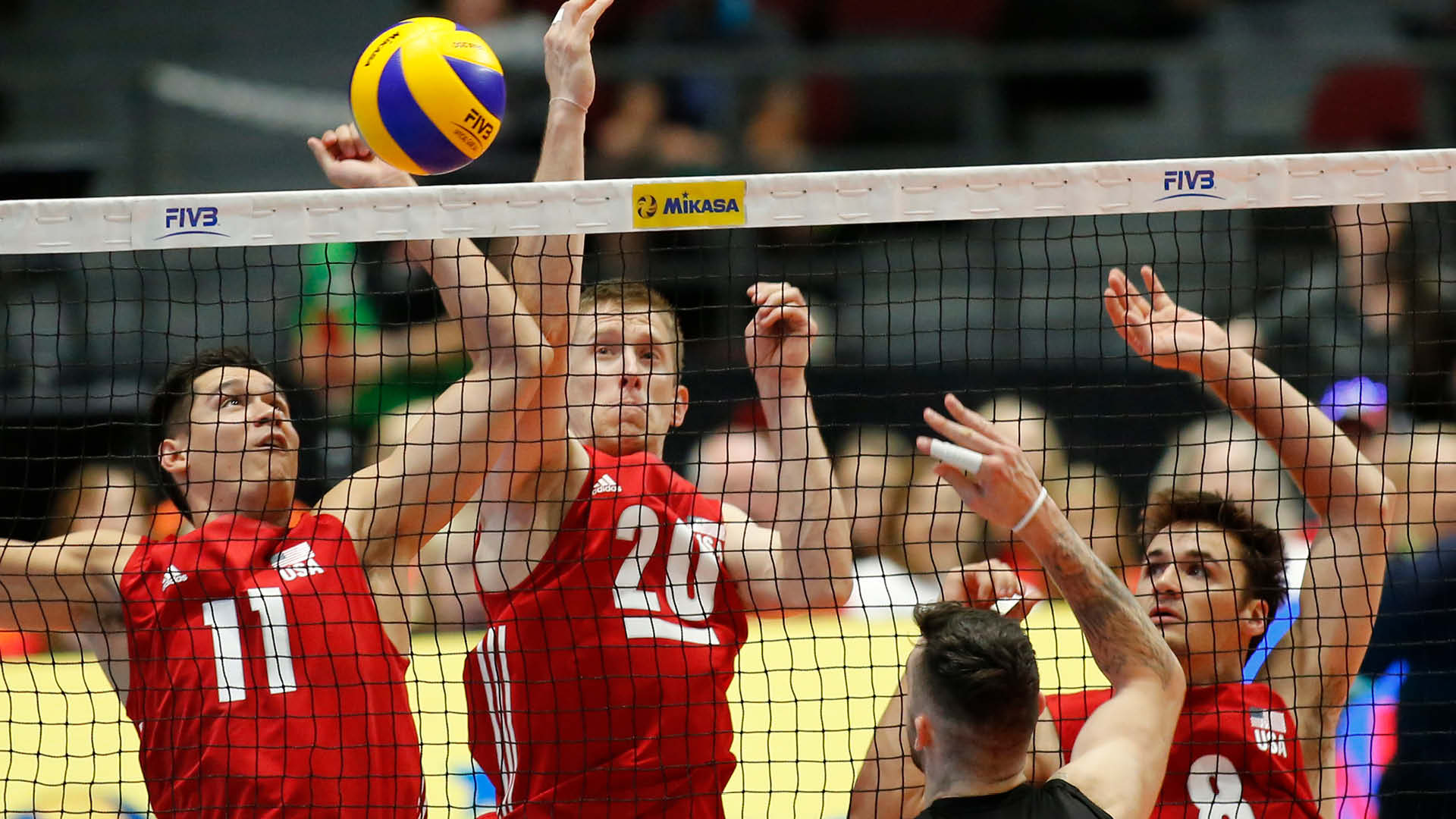 FIVB players at the net
